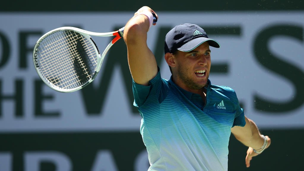 Dominic Thiem of Austria in action against Milos Raonic of Canada during their men's singles semifinal at the Indian Wells 2019