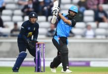 Moeen Ali playing a lofted shot
