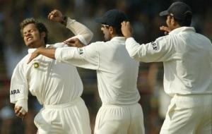 VVS Laxman and Rahul Dravid celebrate with Murali Kartik