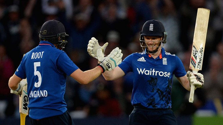 Eoin Morgan and Joe Root celebrate after Morgan reaches his century