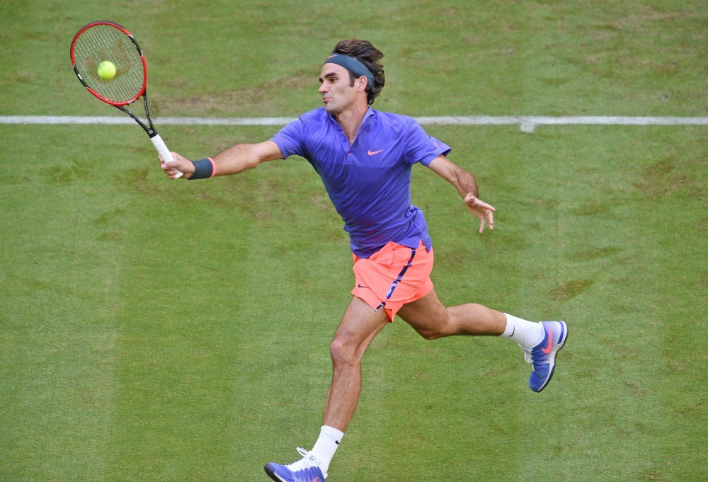 HALLE, GERMANY - JUNE 15: Roger Federer of Switzerland plays a forehand in his match against Philipp Kohlschreiber of Germany during day one of the Gerry Weber Open at Gerry Weber Stadium on June 15, 2015 in Halle, Germany.