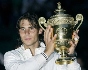 Spain's Rafael Nadal holds his trophy aloft as he celebrates his defeat of Switzerland's Roger Federer in the men's singles final on the Centre Court at Wimbledon, Sunday, July 6, 2008. (AP Photo/Anja Niedringhaus)
