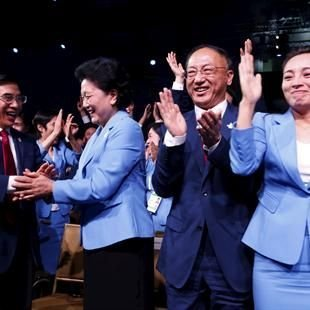 China's vice premier Liu Yandong celebrates with the Beijing delegation