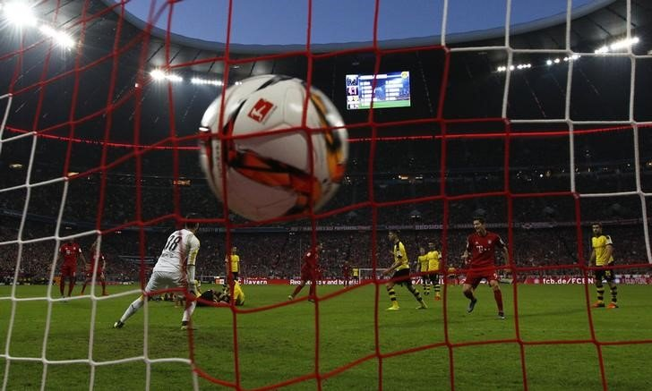 Bayern Munich's Goetze scores a goal against Borussia Dortmund during their German first division Bundesliga soccer match in Munich
