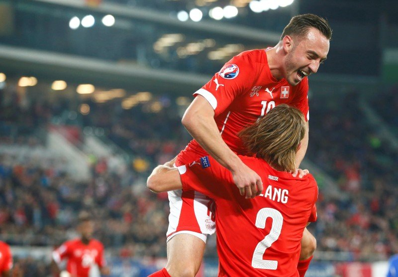 Switzerland's Lang celebrates his goal with team mate Drmic during their soccer match against San Marino's in St. Gallen