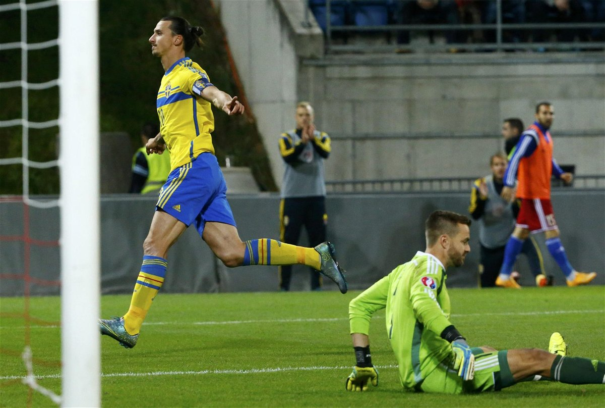 Sweden's Ibrahimovic scores a goal against Liechtenstein's goalkeeper Jehle during their soccer match in Vaduz