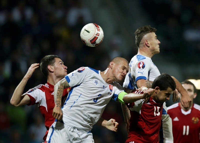 Slovakia's Skrtel fights for the ball with Belarus' Kislyak during their Euro 2016 qualifying soccer match in Zilina