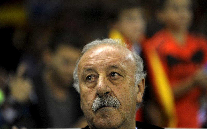 Spain coach Vicente del Bosque listens to the national anthem before their Euro 2016 Group C qualification soccer match against Luxembourg in Logrono