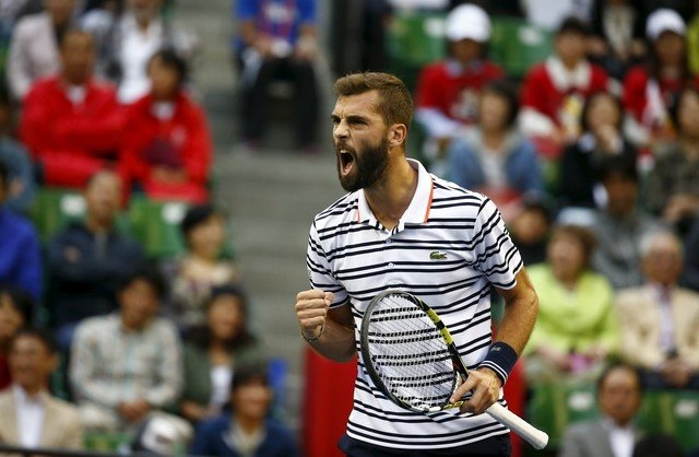 Benoit Paire of France reacts after winning a point against Japan's Kei Nishikori during their men's singles semifinal match at the Japan Open tennis championships in Tokyo