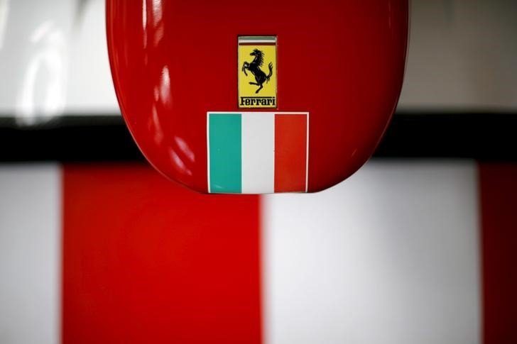 A Ferrari logo and a Italian flag are pictured on a replica of a Ferrari Formula One car in Santiago city