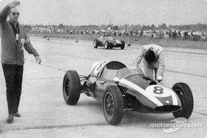 Jack Brabham pushing his car over the finish line. Credits- motorsports