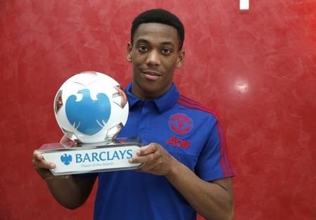 Football - Manchester United Training Ground - 15/10/15 Manchester United's Anthony Martial receives the Barclays Player of Month Award Mandatory Credit: Action Images / Lee Smith Livepic