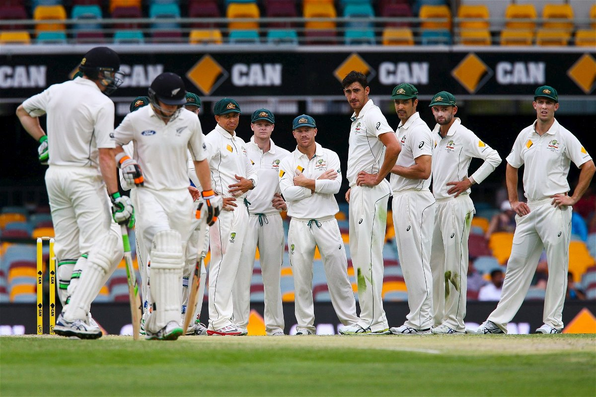 Australian players wait to see whether the New Zealand batsmen will challenge a decision with the DRS (Decision Review System) for the wicket of New Zealand batsman Tom Latham (second L) off the bowling of Mitchell Marsh, during the first cricket test match between Australia and New Zealand in Brisbane, November 8, 2015. REUTERS/Patrick Hamilton