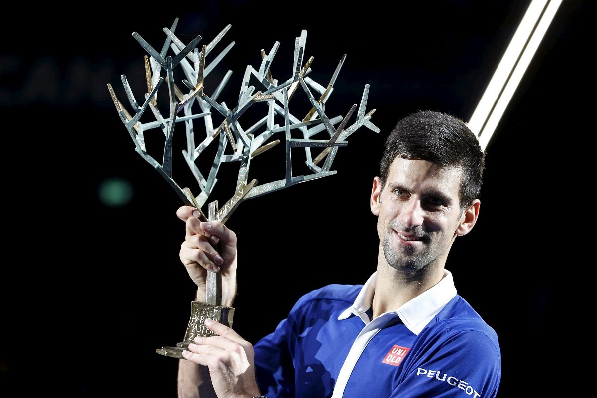 Djokovic poses with the trophy after beating Murray in their men's singles final tennis match at the Paris Masters tennis tournament