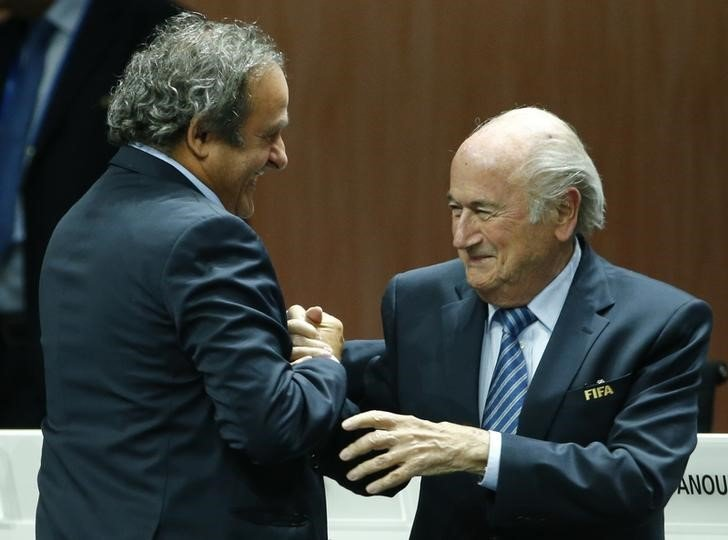 UEFA President Michel Platini (L) congratulates FIFA President Sepp Blatter after he was re-elected at the 65th FIFA Congress in Zurich, Switzerland, May 29, 2015. REUTERS/Ruben Sprich
