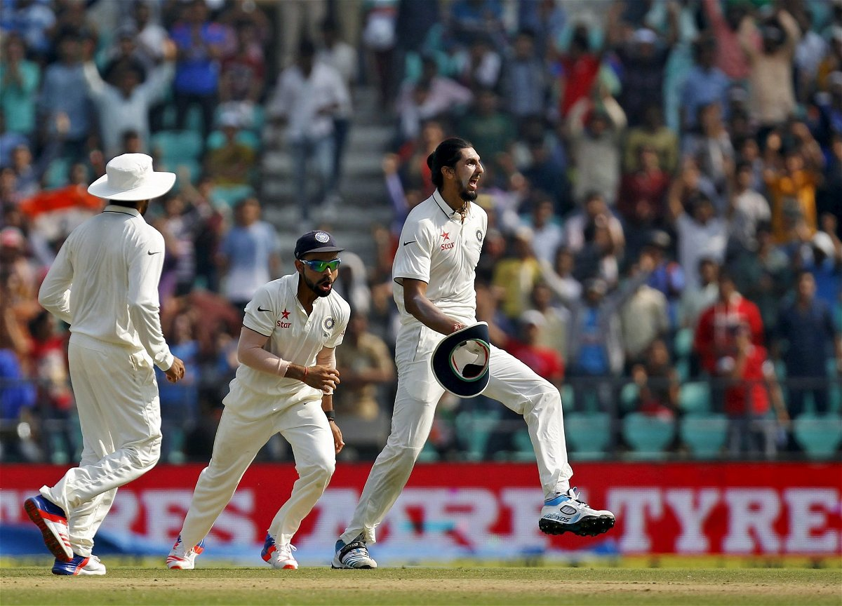 India's Sharma and captain Kohli celebrate after the dismissal of South Africa's Villiers during the third day of their third test cricket match in Nagpur