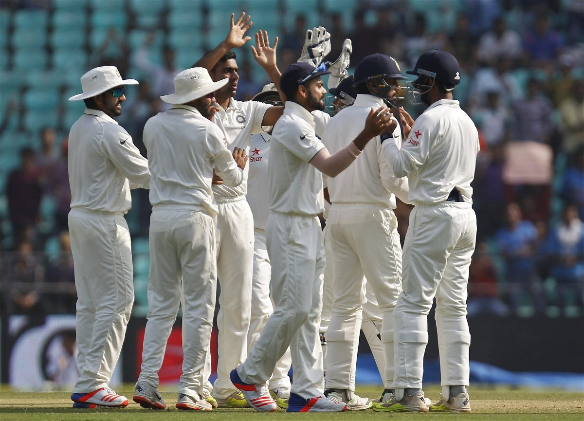 India's Ashwin celebrates along with his teammates after taking the wicket of South Africa's Elgar during the third day of their third test cricket match in Nagpur