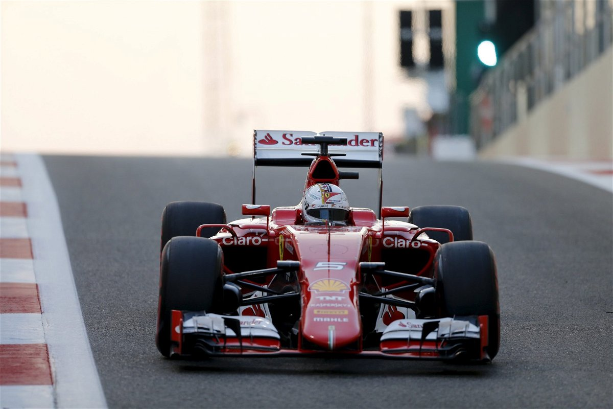 Ferrari Formula One driver Sebastian Vettel of Germany leaves the pit lane during qualifying session of Abu Dhabi F1 Grand Prix at the Yas Marina circuit in Abu Dhabi