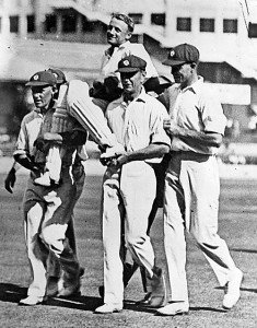 Don Bradman is carried by his team-mates.