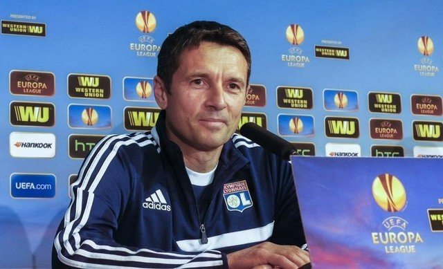 Olympique Lyon's coach Remi Garde attends a news conference at the Gerland stadium in Lyon