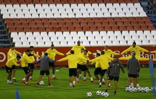 Sevilla's players attend a training session ahead of their Champions League soccer match against Manchester City in Seville
