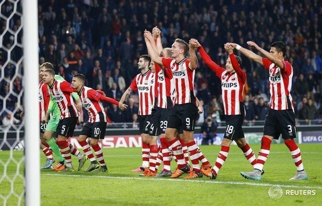 PSV Eindhoven's players celebrate after defeating Wolfsburg in their Champions League soccer match in Eindhoven