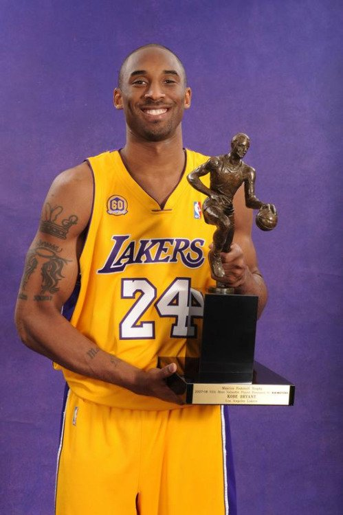 Bryant with the MVP Trophy he won in 2008