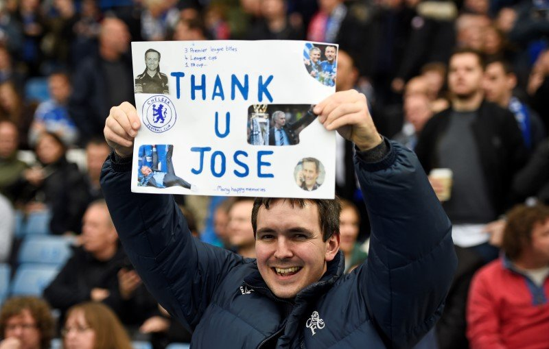Football Soccer - Chelsea v Sunderland - Barclays Premier League - Stamford Bridge - 19/12/15. Chelsea fan poses with a banner for Jose Mourinho before the game Reuters / Dylan Martinez. Livepic