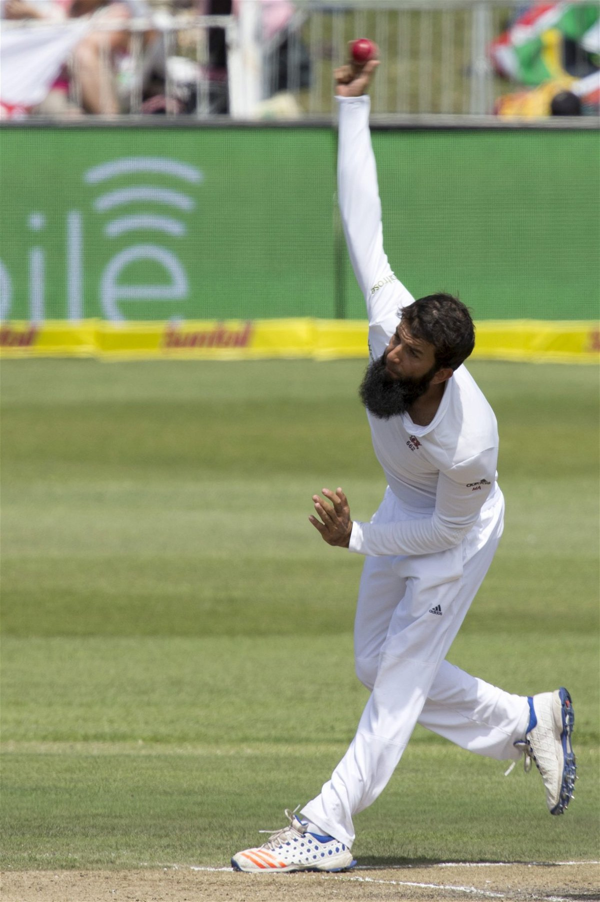 England's Moeen Ali bowls during the first cricket test match against South Africa in Durban