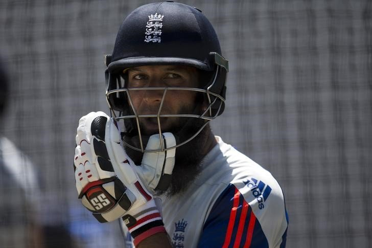 England's Moeen Ali adjusts his helmet during a training session in Durban