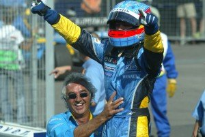 2003 Hungarian Grand Prix -Sunday Race, Budapest, Hungary. 24th August 2003. Fernando Alonso, Renault R23 and Flavio Briatore after winning the Hungarian Grand Prix. World Copyright LAT Photographic. Digital Image Only.