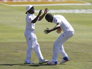 South Africa's Temba Bavuma (left) and Kagiso Rabada celebrate the wicket of England's Nick Compton (not in picture) during the second cricket test match in Cape Town, South Africa, January 2, 2016. REUTERS/Mike Hutchings