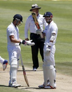 England's Alex Hales celebrates scoring a half century with Nick Compton (left) during the second cricket test match against South Africa in Cape Town, South Africa, January 2, 2016. REUTERS/Mike Hutchings