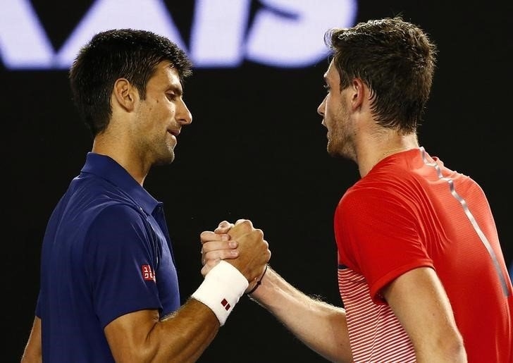 Serbia's Djokovic and France's Halys shake hands after Djokovic won their second round match at the Australian Open tennis tournament at Melbourne Park