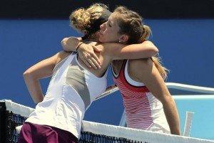 Germany's Annika Beck (R) hugs compatriot Laura Siegemund after Beck won their third round match at the Australian Open tennis tournament at Melbourne Park, Australia, January 23, 2016. REUTERS/John French
