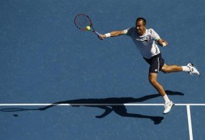 Czech Republic's Lukas Rosol jumps to hit a shot during his third round match against Switzerland's Stan Wawrinka at the Australian Open tennis tournament at Melbourne Park, Australia, January 23, 2016. REUTERS/Jason Reed
