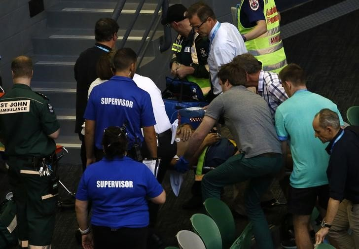 Nigel Sears, coach of Serbia's Ana Ivanovic, is carried away on a stretcher after he collapsed during Ivanovic's third round match against Madison Keys of the U.S., causing play to be suspended, at the Australian Open tennis tournament at Melbourne Park, Australia, January 23, 2016. REUTERS/Jason Reed