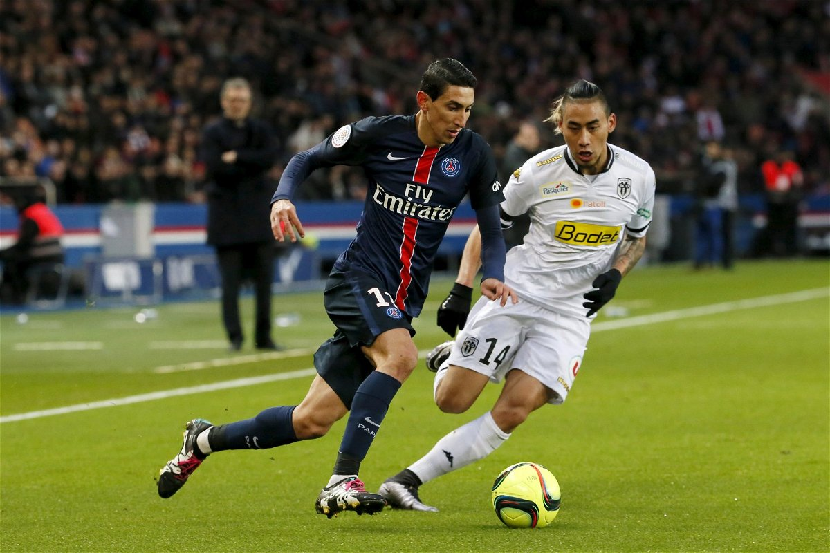Football Soccer - Paris St Germain vs Angers - French Ligue 1 - Parc des Princes, Paris, France - 23/1/16. Paris St Germain's Angel Di Maria in action with Angers' Billy Ketkeophomphone. REUTERS/Gonzalo Fuentes