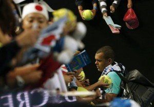 France's Jo-Wilfried Tsonga signs autographs after losing his fourth round match against Japan's Kei Nishikori at the Australian Open tennis tournament at Melbourne Park, Australia, January 24, 2016. REUTERS/Tyrone Siu