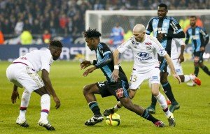 Football Soccer - Olympique Lyon v Olympique Marseille - French Ligue 1 - Grand Stade stadium, Decines, France - 24/1/2016 Olympique Lyon's Christophe Jallet (R) in action against Olympique Marseille's Michy Batshuayi (C)  REUTERS/Robert Pratta