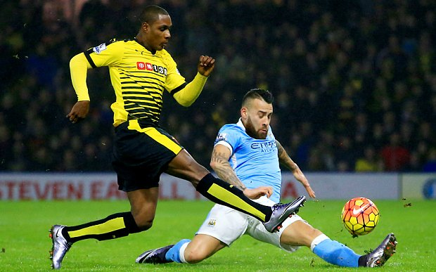 Watford's Odion Ighalo (left) and Manchester City's Nicolas Otamendi battle for the ball during the Barclays Premier League match at Vicarage Road, London.