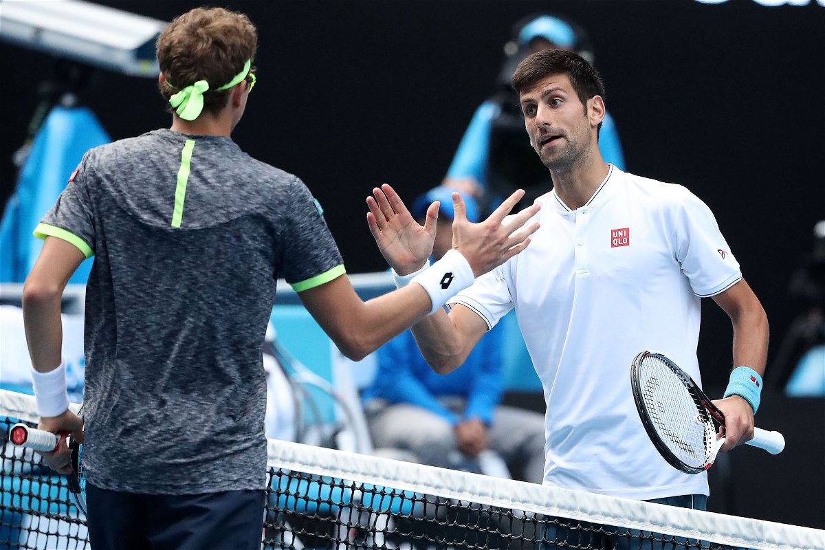 MELBOURNE, AUSTRALIA - JANUARY 19: Novak Djokovic of Serbia congratulates Denis Istomin of Uzbekistan after winning their second round match on day four of the 2017 Australian Open at Melbourne Park on January 19, 2017 in Melbourne, Australia. (Photo by Scott Barbour/Getty Images)