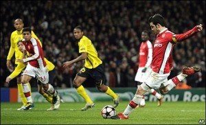 Cesc Fabregas bundles home the equaliser from the penalty spot