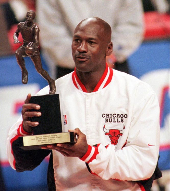 Michael Jordan with one of his five MVPs