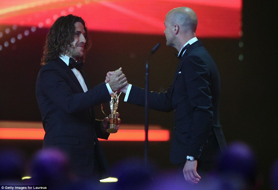 Jordi Cruyff received the Laureus Spirit of Sport award from Carles Puyol on behalf of his father, Johan, who passed away in March