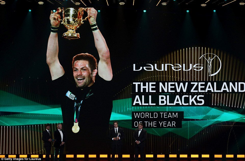 Former New Zealand captain Richie McCaw lifts the Laureus Team of the Year award
