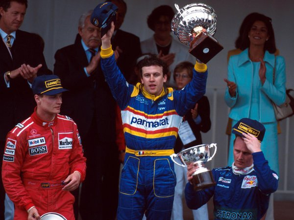 Olivier Panis celebrating his win. The 3 drivers on the podium were the only drivers to finish the race.