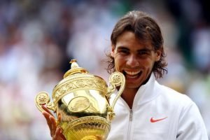 LONDON, ENGLAND - JULY 04:  Rafael Nadal of Spain holds the Championship trophy after winning the Men's Singles Final match against Tomas Berdych of Czech Republic on Day Thirteen of the Wimbledon Lawn Tennis Championships at the All England Lawn Tennis and Croquet Club on July 4, 2010 in London, England.  (Photo by Julian Finney/Getty Images)