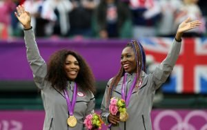 Serena and Venus Williams celebrating their Women's Doubles success at the 2012 London Olympics.