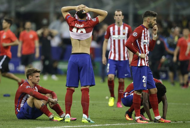 Atletico's players react after the Champions League final soccer match between Real Madrid and Atletico Madrid at the San Siro stadium in Milan, Italy, Saturday, May 28, 2016. Real Madrid won 5-4 on penalties after the match ended 1-1 after extra time. (AP Photo/Andrew Medichini)